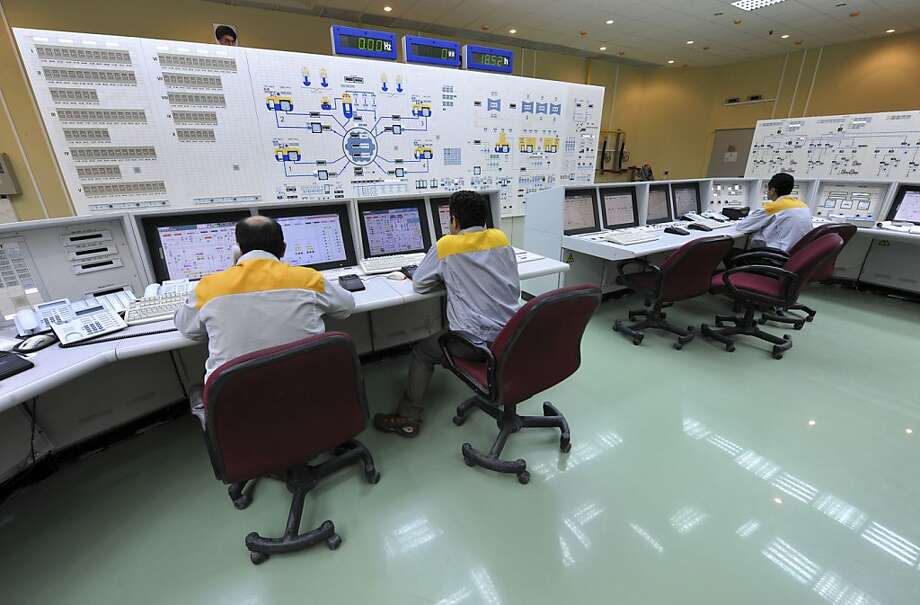 Iranian technicians work at the Bushehr nuclear power plant in 2010. Its control systems were penetrated by the computer worm. Photo: Ebrahim Norouzi, AP