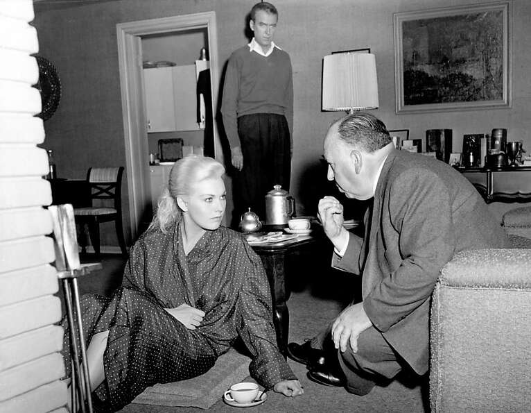 Kim Novak, top left, gets instructions from Alfred Hitchcock on the set of