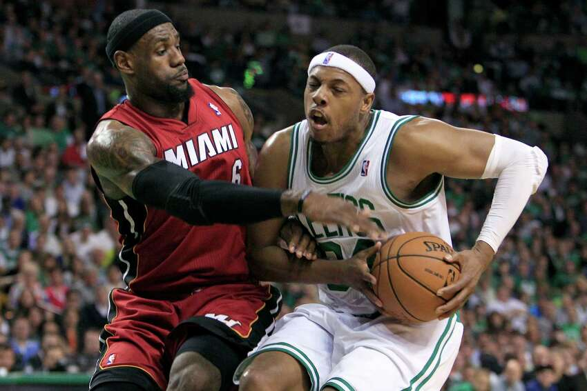 Miami Heat forward LeBron James, left, defends against Boston Celtics forward Paul Pierce, right, during the first quarter in Game 6 of the NBA basketball Eastern Conference finals, Thursday, June 7, 2012, in Boston. (AP Photo/Elise Amendola)