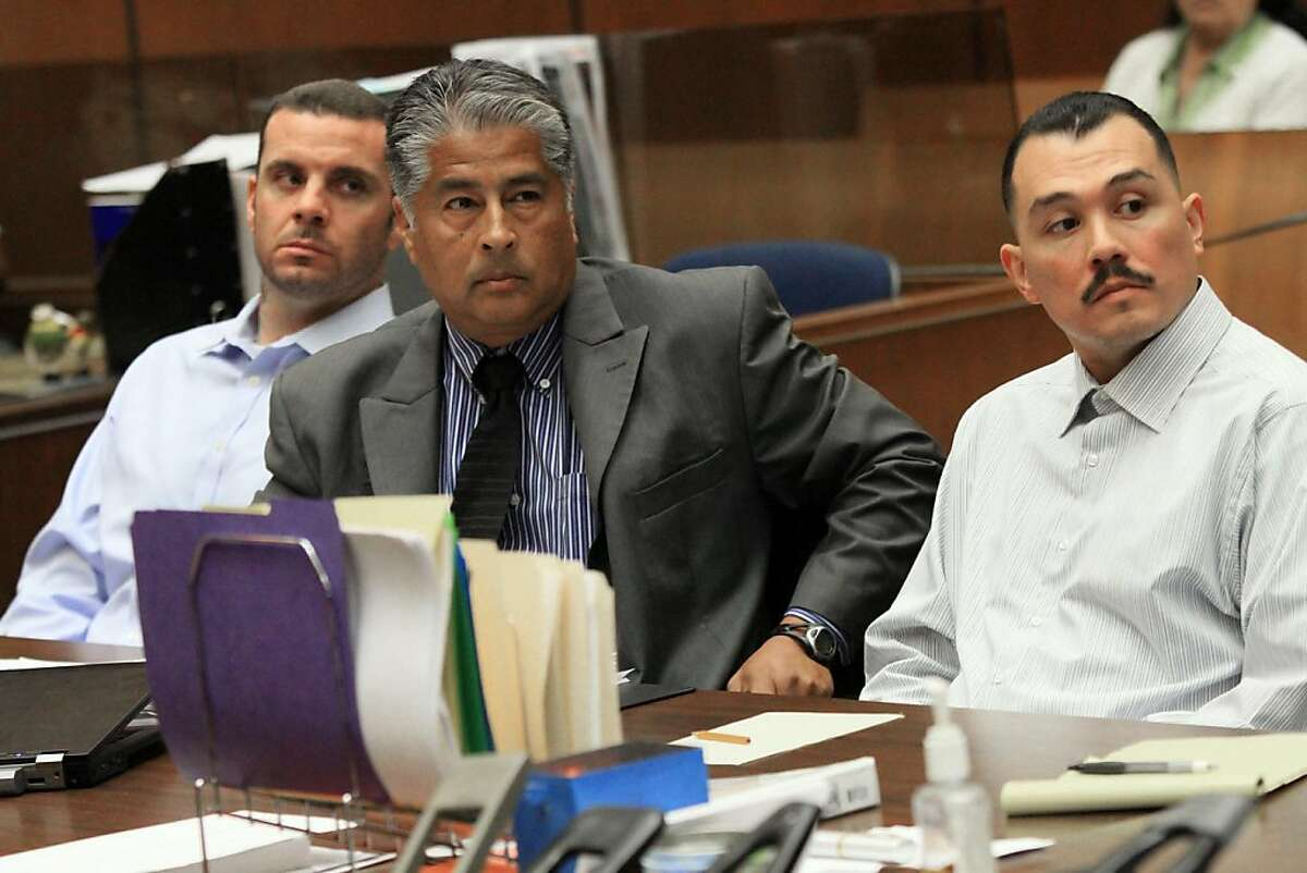 FILE - In this May 31, 2012 file photo, Marvin Norwood , left, with attorney Victor Escobedo, center, and co-defendant Louie Sanchez appear during a preliminary hearing held in Los Angeles Superior court. Dorene Sanchez, the woman who drove two men from Dodger Stadium the night of the attack on Bryan Stow planned to testify Thursday, June 7, 2012 in the preliminary hearing to determine whether Sanchez and Norwood will stand trial on charges of mayhem and assault in the attack that permanently disabled Stow with brain damage. Dorene Sanchez is the sister of defendant Louie Sanchez and was said to be romantically involved with defendant Marvin Norwood.