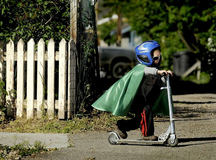 With his cape flying in the wind behind him, Declan Crawford, 3, works to catch up with his grandmother Thursday, June 7, 2012 while on a morning walk through a Missoula, Mont., neighborhood. (AP Photo/Missoulian/Kurt Wilson) Photo: Kurt Wilson, Associated Press