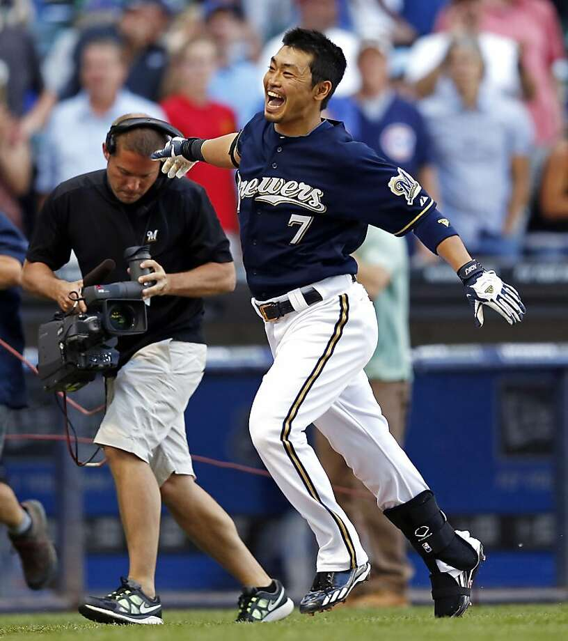Milwaukee Brewers' Norichika Aoki (7) celebrates his walkoff home run off Chicago Cubs' Casey Coleman in the 10th inning of a baseball game on Thursday, June 7, 2012, in Milwaukee. The Brewer won 4-3 in 10 innings. (AP Photo/Tom Lynn) Photo: Tom Lynn, Associated Press