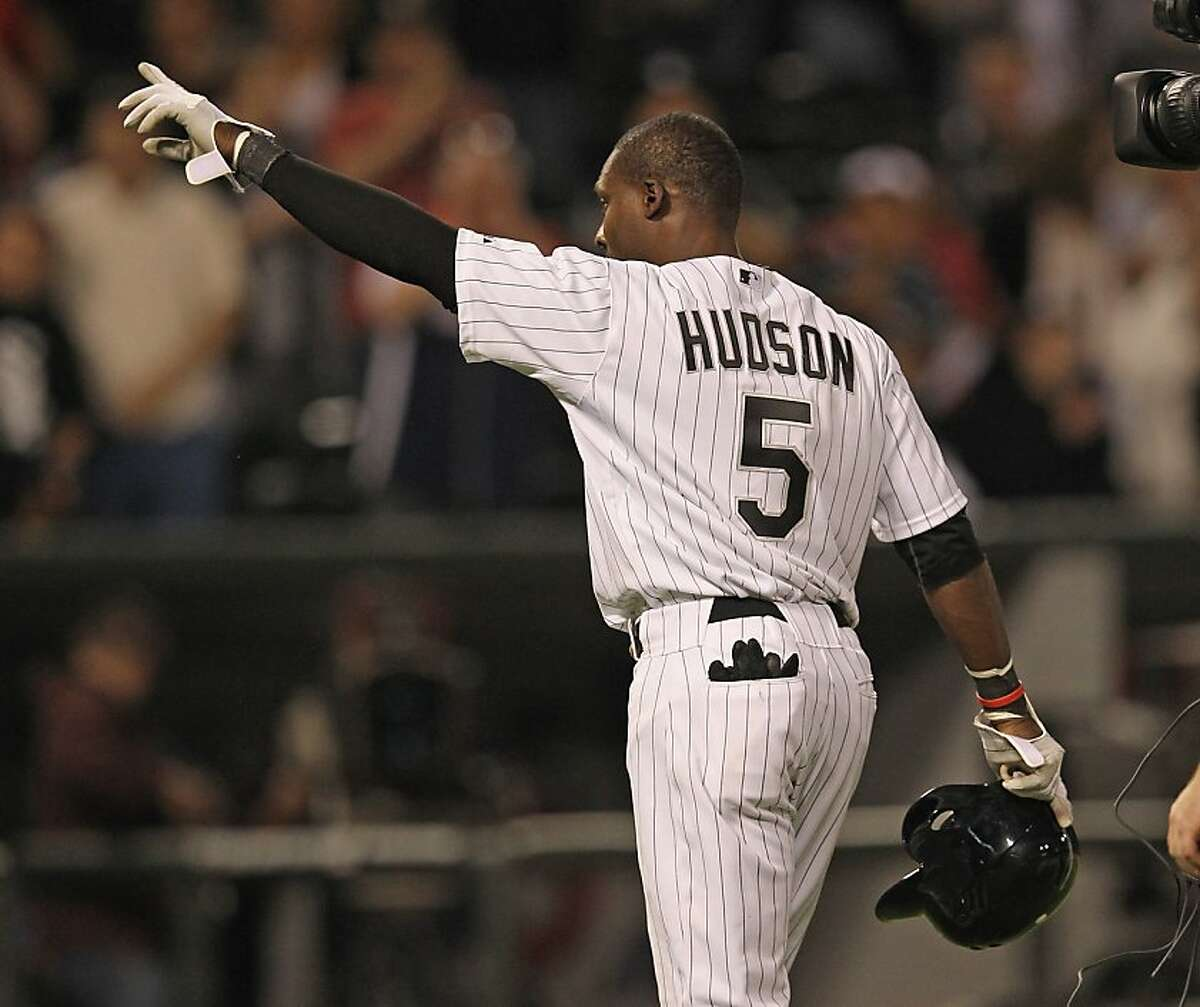 CHICAGO, IL - JUNE 07: Orlando Hudson #5 of the Chicago White Sox points to the crowd after getting the game-winning hit in the bottom of the 9th inning against the Toronto Blue Jays at U.S. Cellular Field on June 7, 2012 in Chicago, Illinois. The White Sox defeated the Blue Jays 4-3. (Photo by Jonathan Daniel/Getty Images)
