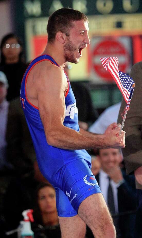 Coleman Scott reacts after beating Shawn Bunch for a spot on U.S. Olympic men's freestyle wrestling team, during an event in New York's Times Square on Thursday, June 7, 2012. The 26-year-old Oklahoma State alum had to win twice Thursday in a wrestle-off at 132 pounds. Scott beat Reece Humphrey, then defeated Shawn Bunch in a best-of-three championship series. Photo: Frank Franklin II, AP / AP