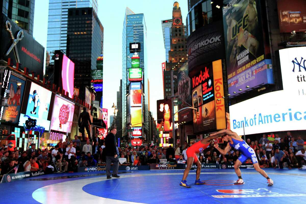 Coleman Scott, right, competes with Shawn Bunch during the Grapple in the Apple freestyle wrestling event in New York's Times Square, Thursday, June 7, 2012. Scott secured the victory over Bunch with a five-point throw in the second period of the third match.