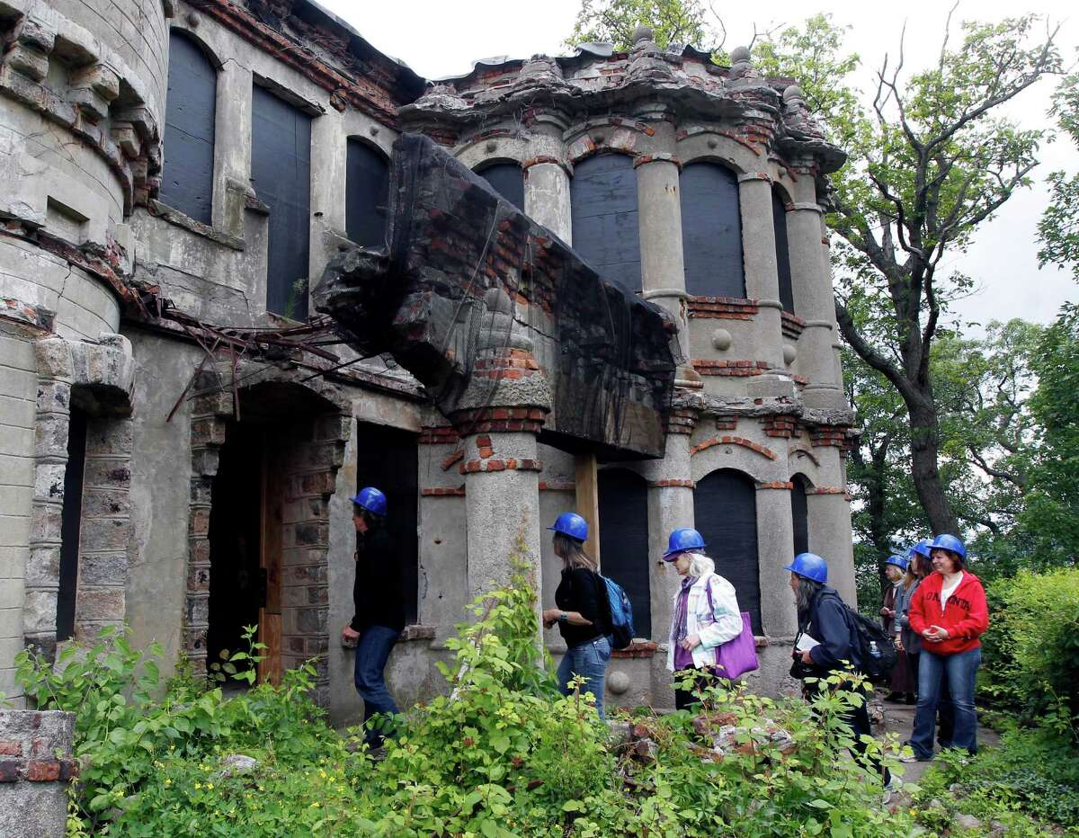 Media and tourism officials enter the Bannerman residence during a tour of the Bannerman Castle on Pollepel Island, N.Y., on Tuesday, June 5, 2012. Though it looks like it was built to withstand battering rams, it was actually a surplus military goods warehouse made to resemble a Scottish castle. Businessman Francis Bannerman VI had it built early in the 20th century as a place to store helmets, haversacks, mess kits and munitions he could not store in his thriving shop in Manhattan.