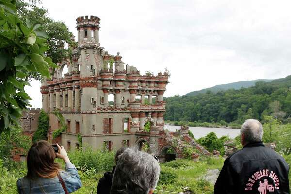 Media and tourism officials photograph Bannerman's Island Arsenal  on Pollepel Island, N.Y., on Tuesday, June 5, 2012. Though it looks like it was built to withstand battering rams, it was actually a surplus military goods warehouse made to resemble a Scottish castle. Businessman Francis Bannerman VI had it built early in the 20th century as a place to store helmets, haversacks, mess kits and munitions he could not store in his thriving shop in Manhattan.