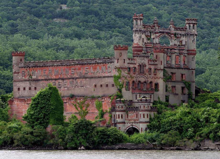 The Bannerman's Island Arsenal is seen on the Hudson River on Pollepel Island, N.Y., on Tuesday, June 5, 2012. Though it looks like it was built to withstand battering rams, it was actually a surplus military goods warehouse made to resemble a Scottish castle. Businessman Francis Bannerman VI had it built early in the 20th century as a place to store helmets, haversacks, mess kits and munitions he could not store in his thriving shop in Manhattan. Photo: Mike Groll, AP / AP
