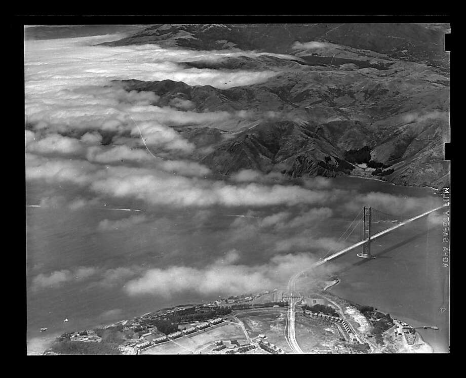 Aerial photo of Golden Gate Bridge with fog in Marin taken on an unknown date. The Chronicle library envelope says it was shot on opening day, but there is no foot traffic and minimal vehicle traffic on the bridge. Photo: San Francisco Chronicle
