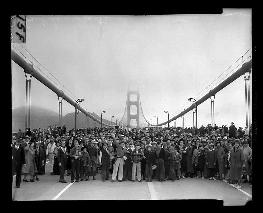 Pedestrians walk across the Golden Gate Bridge on May 27, 1937.  Photo: San Francisco Chronicle