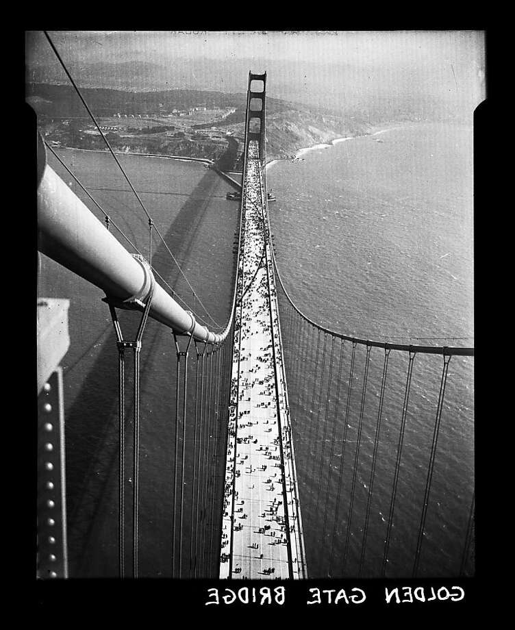 Golden Gate Bridge opening day photo taken from the north tower on May 27, 1937. San Francisco Chronicle archive photos of the Golden Gate Bridge construction and opening to the public. The city of San Francisco will celebrate the Golden Gate Bridge's 75th anniversary on Sunday, May 27, 2012. Photo: San Francisco Chronicle