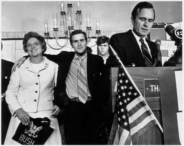 HOUCHRON CAPTION (04/11/1999): George W. Bush, center, joins his mother, Barbara Bush, and brother, Jeb Bush, rear, in Houston as father George Bush acknowledges defeat in Texas' 1970 U.S. Senate race. The younger Bush campaigned vigorously for his father in the race against Democrat Lloyd Bentsen Jr.  HOUCHRON CAPTION  (02/16/2003):  George H.W. Bush, right, acknowledges defeat in Texas' 1970 U.S. Senate race. Son George W., center, shown with his mother, Barbara, and brother Jeb, rear, campaigned for his father. Photo: Sam C. Pierson Jr., Houston Chronicle / Houston Chronicle