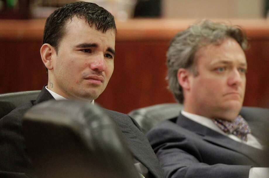 Johoan Rodriguez sits next to Attorney Adam Brown while listening to Defense Attorney Rick Detoto address potential jurors he weeps during jury selection in the 183rd State District Court at the Harris County Criminal Justice Center on Monday, June 4, 2012, in Houston. Rodriguez is having a week-long punishment trial starting today after pleading guilty to intoxication manslaughter in the June 2011 death of Houston Police Officer Kevin Will, 38.  ( Mayra Beltran / Houston Chronicle ) Photo: Mayra Beltran / Houston Chronicle