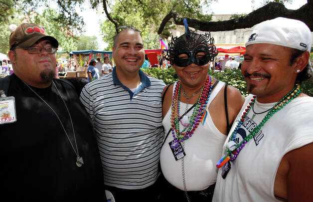 FEATURES; ACS PRIDEFEST JMS; 06/11/11; From the left, Anthony Ridgely, Raul Martinez, Mondo Hernandez and Joseph Santos at Pridefest San Antonio, Saturday, June 11, 2011, at Hemisfair Plaza in San Antonio. ( Photo by J. Michael Short / SPECIAL ) Photo: J. Michael Short, SPECIAL TO THE EXPRESS-NEWS / THE SAN ANTONIO EXPRESS-NEWS