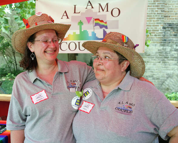 FEATURES / 21SA; ALAMO SCENE PRIDEFEST JMS; 06/13/09; Sherri Sullivan, left, and Chris Longoria take in PrideFest 2009 at HemisFair Park in San Antonio Saturday afternoon, June 13, 2009. ( Photo by J. Michael Short / SPECIAL ) Photo: J. MICHAEL SHORT, SPECIAL TO THE EXPRESS-NEWS/210S / THE SAN ANTONIO EXPRESS-NEWS/210