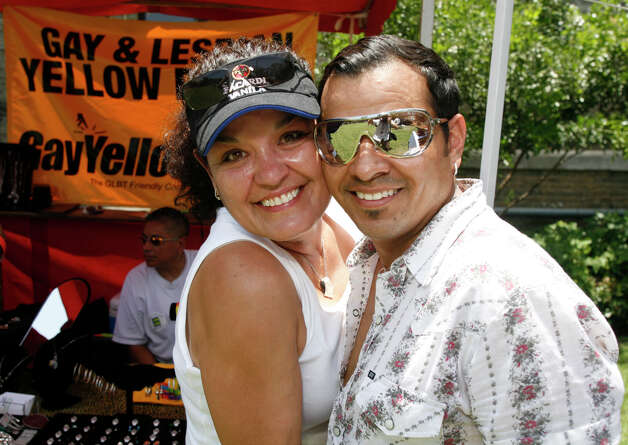 FEATURES / 21SA; ALAMO SCENE PRIDEFEST JMS; 06/13/09; Laura M. Villagran and Etienne Apodaca take in PrideFest 2009 at HemisFair Park in San Antonio Saturday afternoon, June 13, 2009. ( Photo by J. Michael Short / SPECIAL ) Photo: J. MICHAEL SHORT, SPECIAL TO THE EXPRESS-NEWS/210S / THE SAN ANTONIO EXPRESS-NEWS/210
