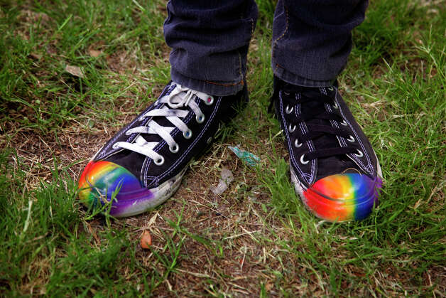 A pair of Converse sneakers were customized for PrideFest San Antonio in Hemisfair Park, Saturday, June 14, 2008. NICOLE FRUGE/nfruge@express-news.net Photo: NICOLE FRUGE, SAN ANTONIO EXPRESS-NEWS / nfruge@express-news.net