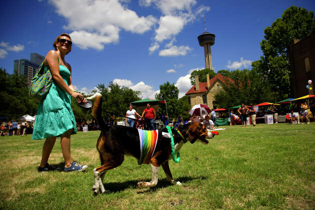 Jeni Spring (CQ) and her dog Lily attend the pet parade during PrideFest San Antonio in Hemisfair Park, Saturday, June 14, 2008. Lily, who is a boy dog thank you very much, won the best large breed dog. NICOLE FRUGE/nfruge@express-news.net Photo: NICOLE FRUGE, SAN ANTONIO EXPRESS-NEWS / nfruge@express-news.net