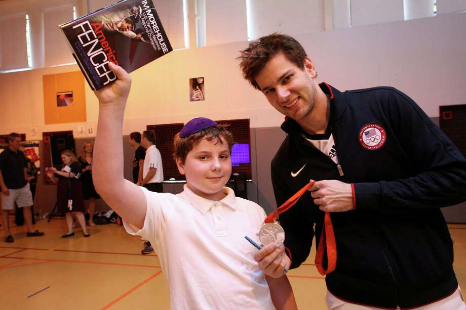 U.S. Olympic fencer and silver medalist Tim Morehouse, right, with Carmel Academy fifth-grader Matthew Smalley after speaking at the school Friday, June 8, 2012. Photo: David Ames / Greenwich Time