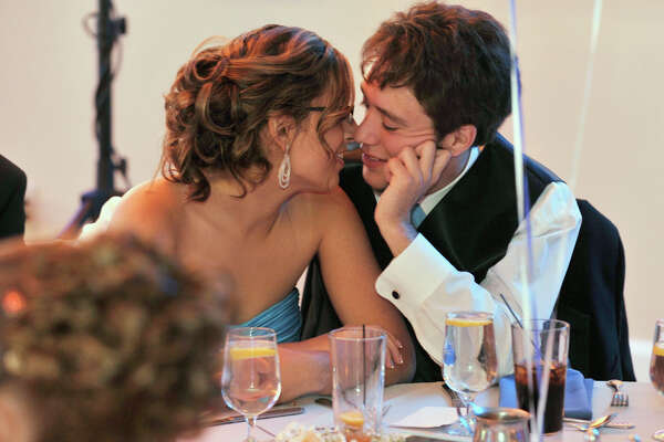 Ana Pinto and her date, P.J. Geary, kiss at their table during the Henry Abbott Technical High School Senior Prom at the Candlewood Inn in Brookfield, Conn., on Thursday, June 7, 2012.