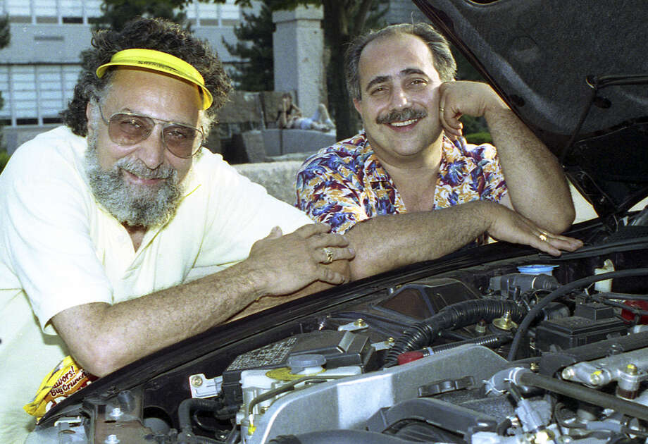 "In this July 9, 1991 file photo, Brothers Tom, left, and Ray Magliozzi pose under a car hood in Boston. The comic mechanics on NPR's ""Car Talk"" said Friday, June 8, 2012 that they will stop making new episodes of their joke-filled auto advice show at the end of September 2012, 25 years after it began. (AP Photo/Susan Walsh, File) Photo: AP Photo/Susan Walsh"