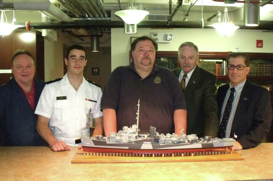 USS Slater Museum Don Preul, from left, curator of the U.S. Naval Academy Museum in Annapolis, Md., Midshipman Mike FitzGibbon of Colonie, Steve Seligman, master model maker; Gordon Lattey of Troy, a USS Slater volunteer, and Greg Krawczyk of Albany, member of the USS Slater Board of Trustees, look at the model of the destroyer escort USS Slater.