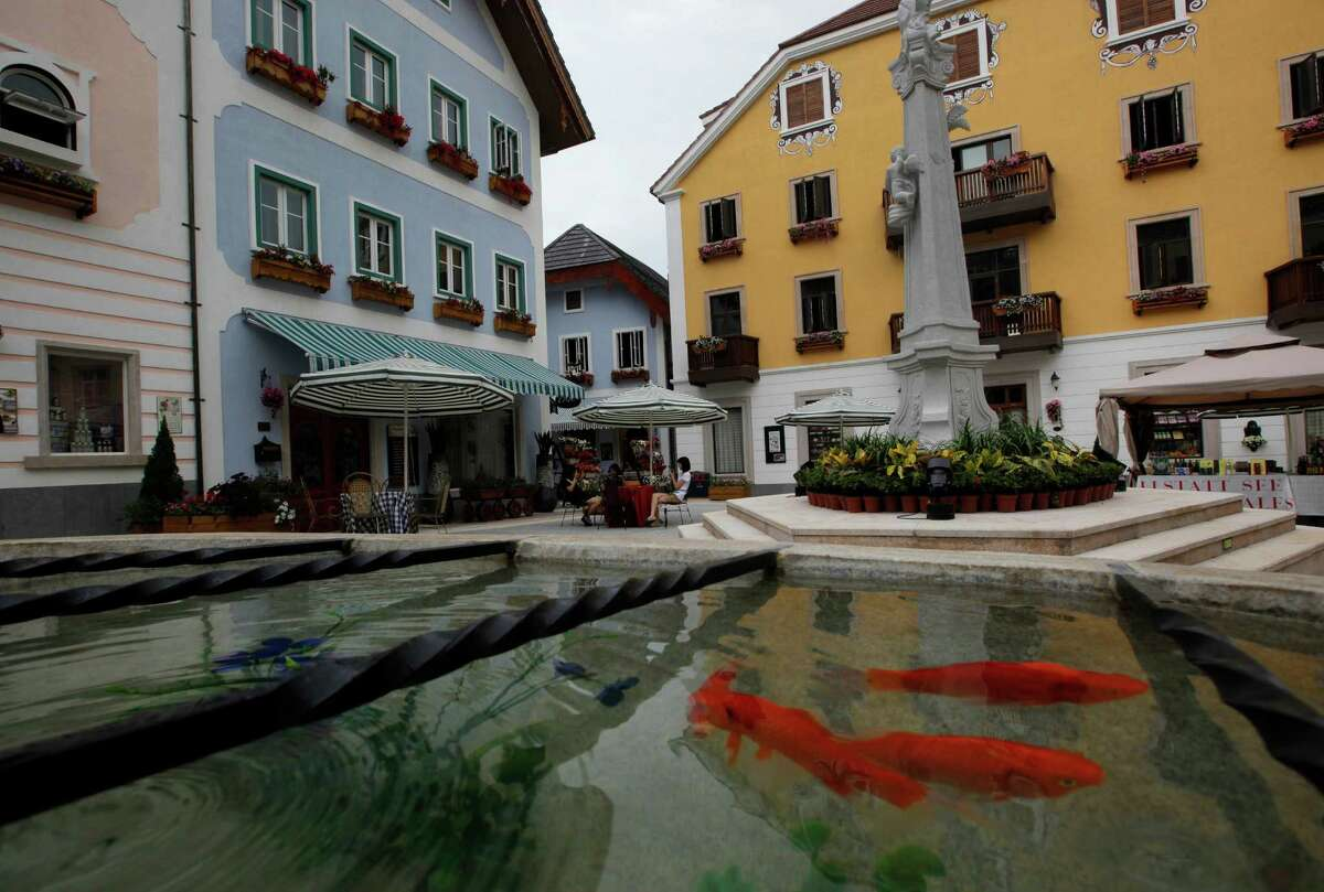 Fish swim in the pond at Hallstatt See, a replica of the Austrian town of Hallstatt, in Boluo county, Huizhou city, south China's Guangdong province, on Saturday, June 2, 2012.