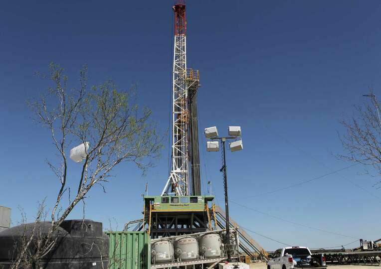 Drilling continues at a rig over the Eagle Ford formation near Cotulla, Texas. (Wednesday March 23,