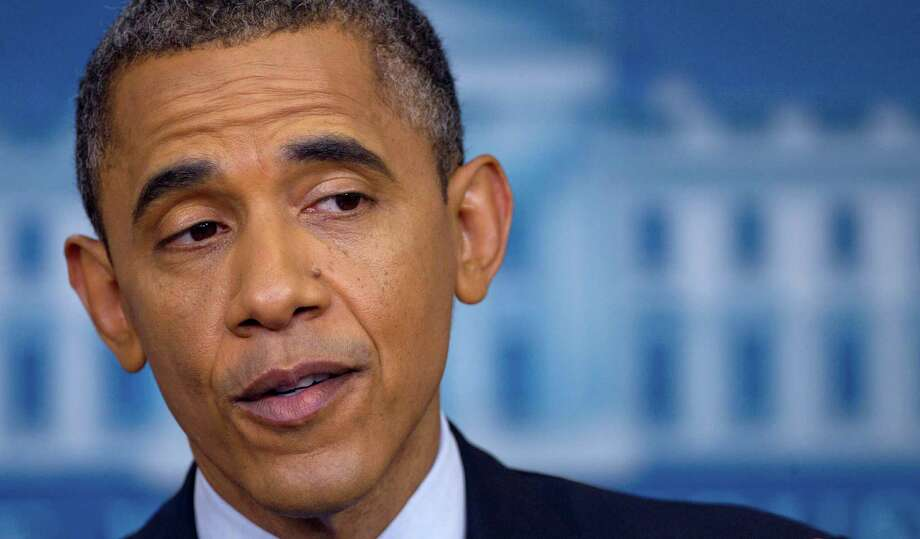 """President Barack Obama's statement """"the private sector is doing fine"""" opened himself to criticism by GOP candidate Mitt Romney. Photo: Associated Press"""