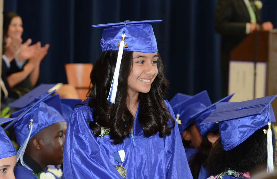 Pamela Valentina Jaramillo, of Stamford, smiles as she is named the 2012 Kruger Cup recipient during the Waterside School fifth grade graduation ceremony in Stamford on Friday, June 8, 2012. Photo: Amy Mortensen / Connecticut Post Freelance