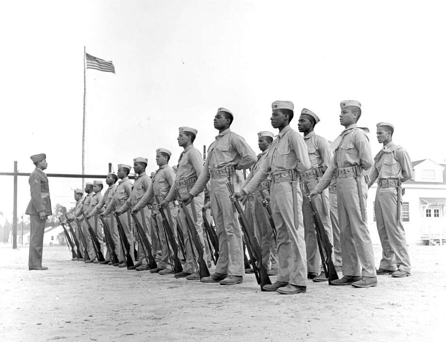 In this April 1943 image provided by the Marine Corps, a platoon of Monfort Marine recruits stand at attention in New River, N.C. / United States Marine Corps