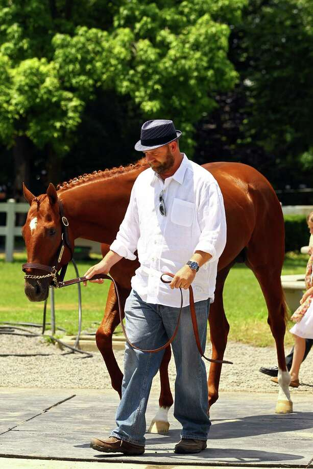 ELMONT, NY - JUNE 08:  Trainer Doug O'Neil walks with I'll Have Another during a press conference outside of barn two on June 8, 2012 in Elmont, New York.    It was announced earlier in the day that I'll Have Another has been scratched from the 2012 Belmont Stakes, ending his bid for a Triple Crown.  (Photo by Al Bello/Getty Images) Photo: Al Bello, Getty Images / 2012 Getty Images