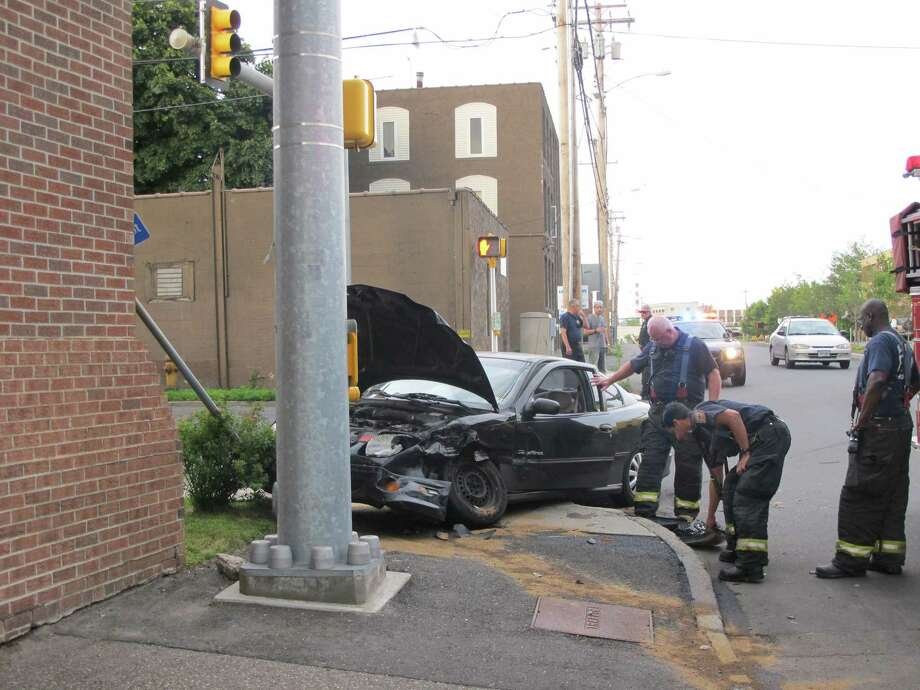 One person was hospitalized with non life-threatening injuries after a two-car accident at the corner of State Street Extension and Dewey Street in Bridgeport, Conn. on Friday, May 8, 2012. Photo: Tom Cleary