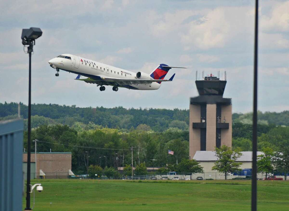 A Delta plane takes off from Albany International Airport on Monday Aug. 22, 2011 in Colonie, NY. ( Philip Kamrass/ Times Union)