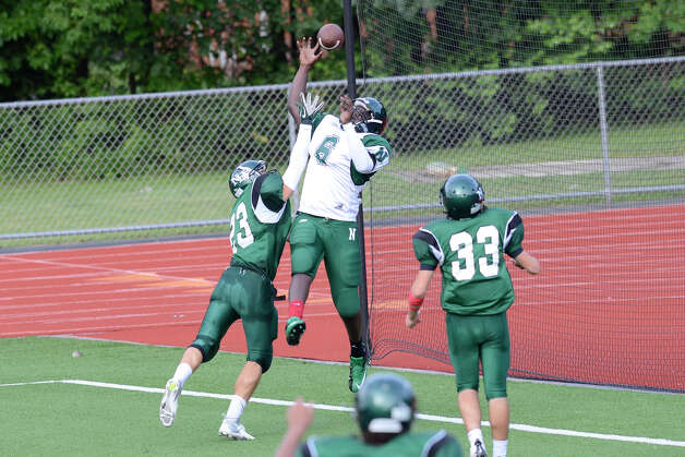 Saeed Soulemane leaps for a pass as Norwalk High School holds the annual Green and White spring football game at Testa field in Norwalk, CT on Friday June 8, 2012. Photo: Shelley Cryan / Shelley Cryan freelance; Stamford Advocate freelance