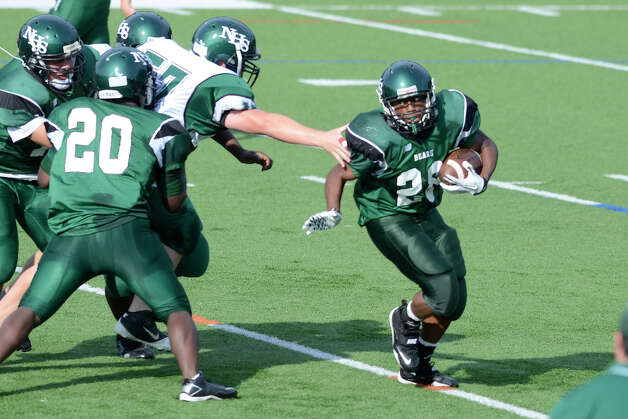 Lance Lauture gains yardage as Norwalk High School holds the annual Green and White spring football game at Testa field in Norwalk, CT on Friday June 8, 2012. Photo: Shelley Cryan / Shelley Cryan freelance; Stamford Advocate freelance