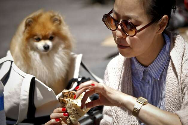 Sunny Kim, left, and her dog, Moody, had pizza at Jonathan Darsky's Del Popolo, a mobile pizzeria housed in a 25ft. shipping container, on Thursday, June 7, 2012 at Mint Plaza in San Francisco, Calif. Photo: Russell Yip, The Chronicle / SF