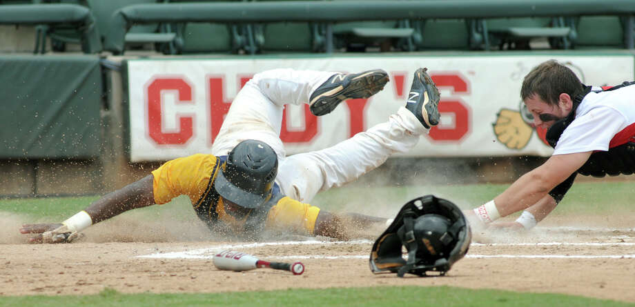 Cy-Ranch senior shortstop Leon Byrd slides safely around the tag of Arlington Martin catcher Collin Lawrence in the top of the third inning of their Class 5A Semi-final versus Arlington Martin at the 2012 UIL State Baseball Championships at Dell Diamond in Round Rock on Friday. Photo: Jerry Baker, For The Chronicle