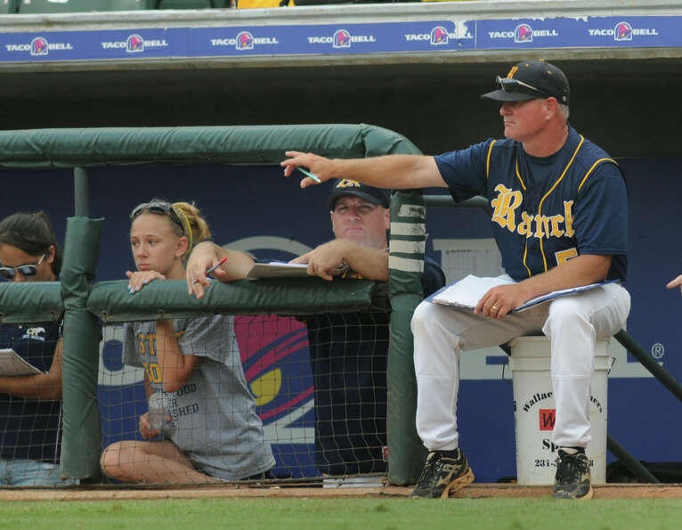 Cypress Ranch Head Coach John Pope, right, positions his infield during the bottom of the inning of