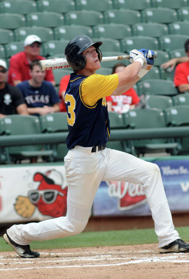 Cy-Ranch sophomore leftfielder Bryce Johnson drives a base hit to right field against Arlington Martin pitcher Nick Hendrix in the top of the third inning of their Class 5A Semi-final at the 2012 UIL State Baseball Championships at Dell Diamond in Round Rock on Friday. Photo: Jerry Baker, For The Chronicle