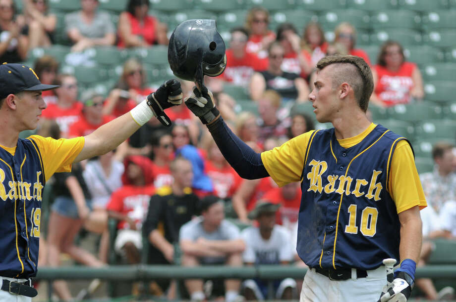 Cy-Ranch sophomore centerfielder Corbin Martin, right, gets a fist bump from teammate and senior 3rd baseman Justin Monsour after Martin scored in the top of the third inning of their Class 5A Semi-final versus Arlington Martin at the 2012 UIL State Baseball Championships at Dell Diamond in Round Rock on Friday. Photo: Jerry Baker, For The Chronicle