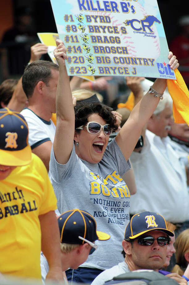 Becky Brosch, center, of Cypress and mom to Cypress Ranch junior pitcher Zach Brosch, cheers for the Mustangs during their Class 5A Semi-final at the 2012 UIL State Baseball Championships at Dell Diamond in Round Rock on Friday. Photo: Jerry Baker, For The Chronicle