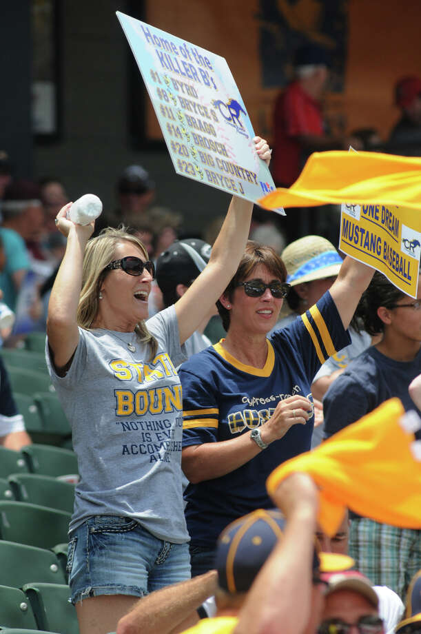 Kim Johnson, from left, mom to Cypress Ranch sophomore leftfielder Bryce Johnson, and her friend Joan Martin cheer for the Mustangs during their Class 5A Semi-final matchup versus Arlington Martin at the 2012 UIL State Baseball Championships at Dell Diamond in Round Rock on Friday. Photo: Jerry Baker, For The Chronicle