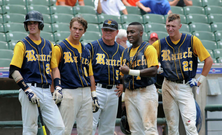 Cy-Ranch rightfielder Zach Smith, from left, Bryce Stark, Head Coach John Pope, Leon Byrd, and Bryce Johnson watch as a new pitcher warms up for Arlington Martin during the top of the 6th inning of their Class 5A Semi-final matchup at the 2012 UIL State Baseball Championships at Dell Diamond in Round Rock on Friday. Photo: Jerry Baker, For The Chronicle