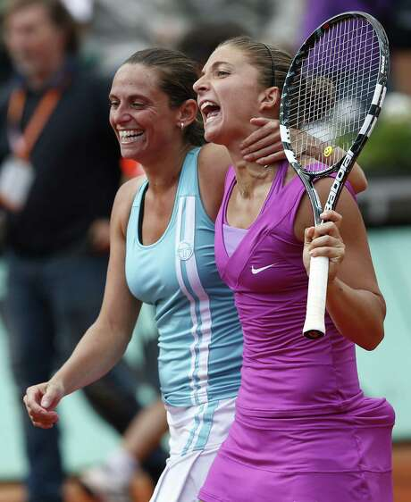 Sara Errani, right, warms up for her first Grand Slam singles final by teaming with fellow Italian Roberta Vinci to win the women's doubles title Friday. Photo: THOMAS COEX / AFP
