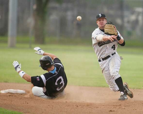 "Westerners"" shortstop Matthew Boulter turns a double play against the Mystic Schooners during Danbury's opener Friday night at Rogers Park. Photo: Barry Horn / The News-Times Freelance"