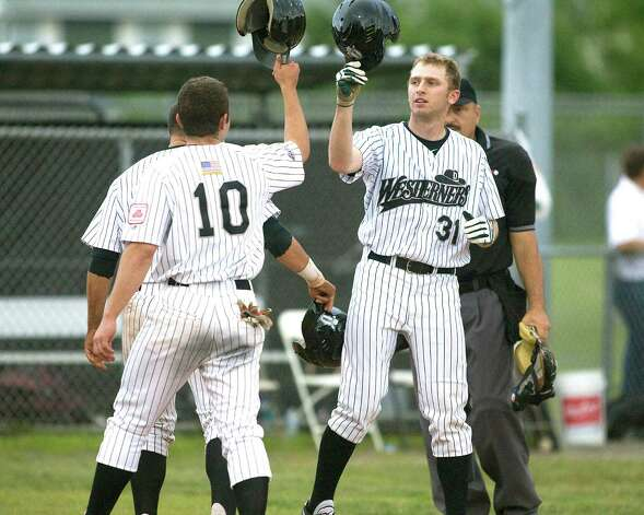 The Westerners' Scott Hagan receives congratulations from Kyle Wernicki after belting Danbury's first homer of the season opening night against the Mystic Schooners Friday at Rogers Park. Photo: Barry Horn / The News-Times Freelance