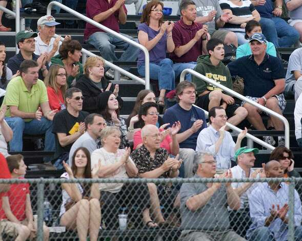 Fans cheer a Westerners' home run by Scott Hagan against the Mystic Schooners opening night at Rogers Park. Photo: Barry Horn / The News-Times Freelance