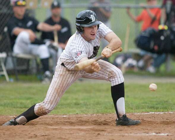 The Westerners' Jake Gronsky lays down a sacrifice bunt against the Mystic Schooners Friday night at Rogers Park. Photo: Barry Horn / The News-Times Freelance