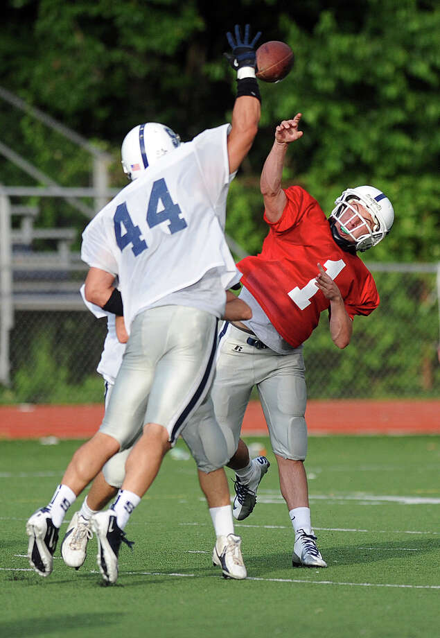 Jack Massie throws a pass during Friday's spring football game at Staples High School on June 8, 2012. Photo: Lindsay Niegelberg / Stamford Advocate